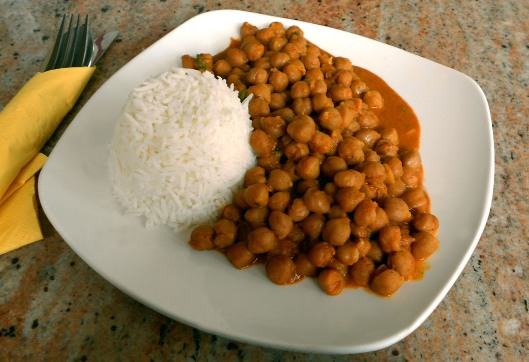 Chick peas cooked with onions and tomatoes and spiced with tumeric ,paprika, cumin, cayenne and fresh ginger!